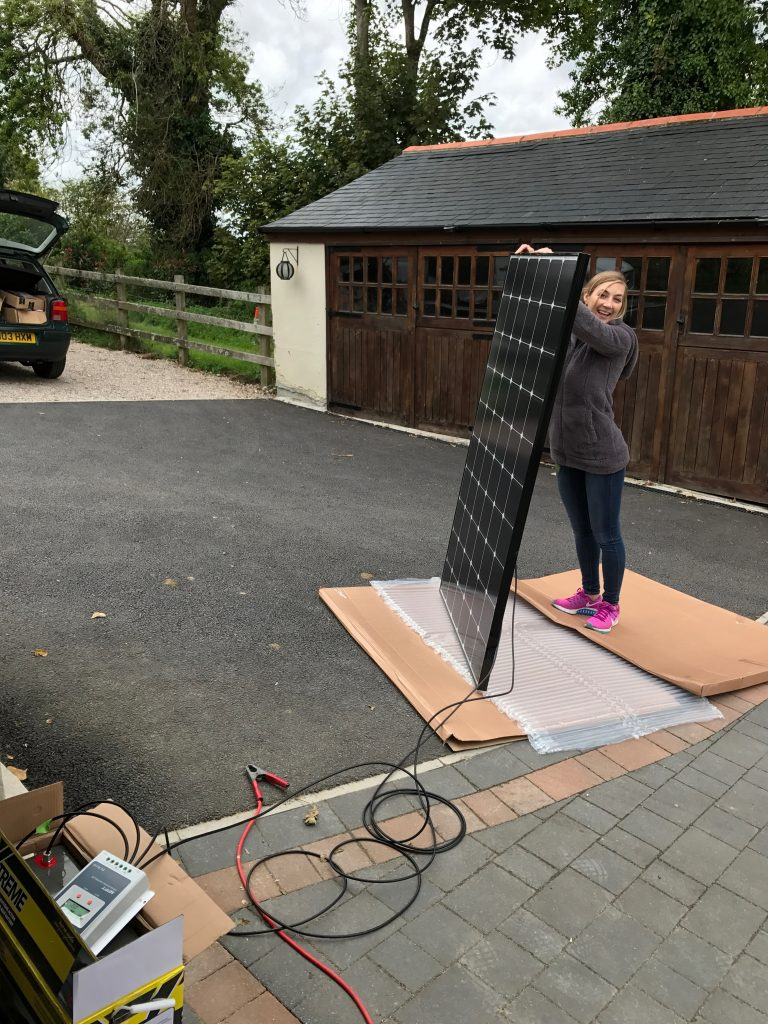 Holding up a solar panel to test it works