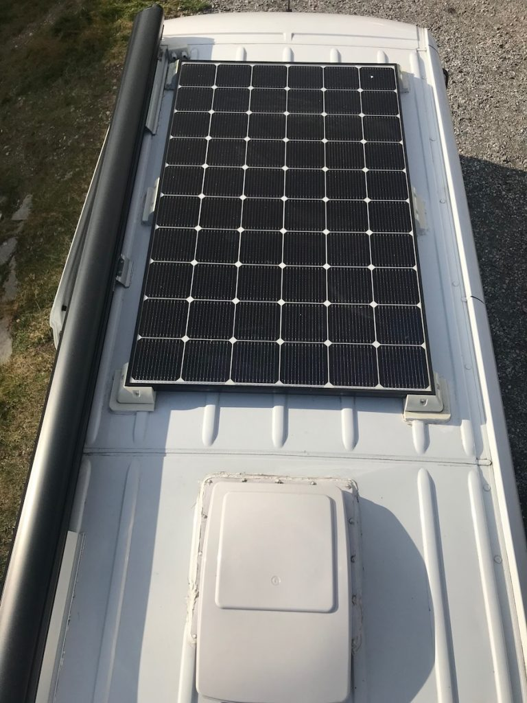 solar panels mounted to roof of van conversion
